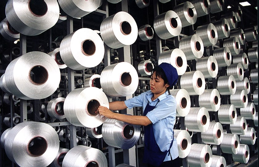 An employee works at a texttile factory in southern Vietnam. Photo: Diep Duc Minh